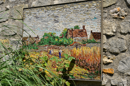 Barbizon, France - july 21 2017 : copy of famous painting on wall on a street wall