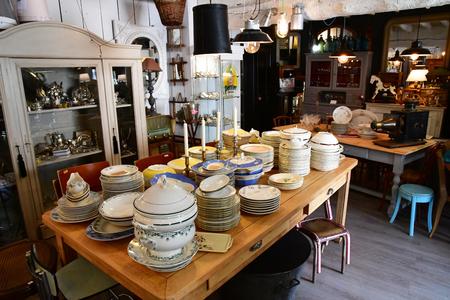 Maulette; France - may 1 2018 : an antique shop in Bois l Epicier Editorial
