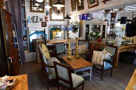 Maulette; France - may 1 2018 : an antique shop in Bois l Epicier