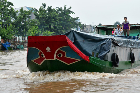 Sa Dec; Socialist Republic of Vietnam - august 18 2018 : a boat on the Mekong Editorial