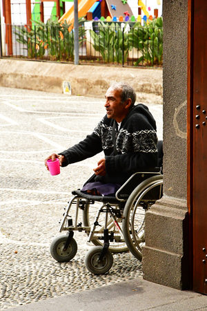 Ribeira Brava; Madeira; Portugal - february 23 2018 : beggar in front of the church