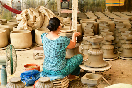 Vinh Long, Socialist Republic of Vietnam - august 17 2018 : woman worrks in a brickworks and pottery workshop