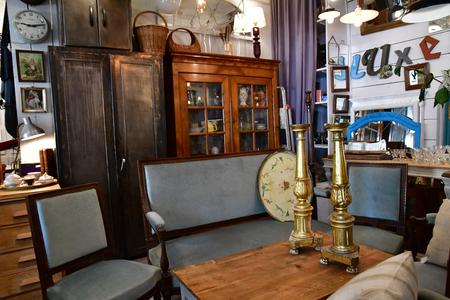 Maulette; France - may 1 2018 : an antique shop in Bois l Epicier Editoriali