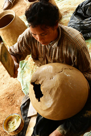 Kampong Chhnang; Kingdom of Cambodia - august 21 2018 : pottery workshop in the picturesque village