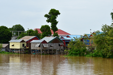 Kampong Chhnang; Kingdom of Cambodia - august 22 2018 : a picturesque floating village near Tonle lake