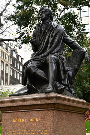 London, England - december 23 2017 : statue of robert burns in the Victoria embankment gardends in the Westminster city