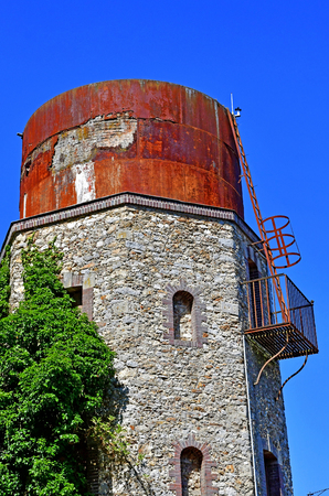 Thoiry; France - august 16 2016 : an old water tower