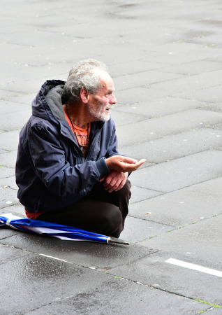 Funchal, Madeira, Portugal - february 21 2018 : an homeless person beg near the cathedral