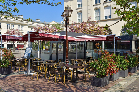 Poissy, France - april 11 2019 : a brasserie in the picturesque city in spring Editöryel