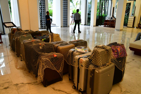 Siem Reap; Kingdom of Cambodia - august 25 2018 : suitcase in an hotel Publikacyjne
