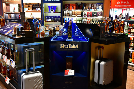 Siem Reap; Kingdom of Cambodia - august 25 2018 : alcohol in a duty free in the airport