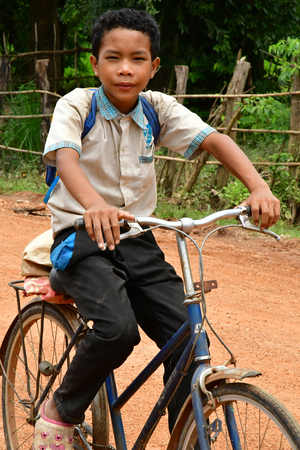 Kampong Chhnang; Kingdom of Cambodia - august 21 2018 : kid are going to school in the picturesque village Editorial