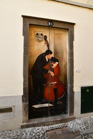Funchal, Portugal - february 21 2018 : painted door in santa Maria street