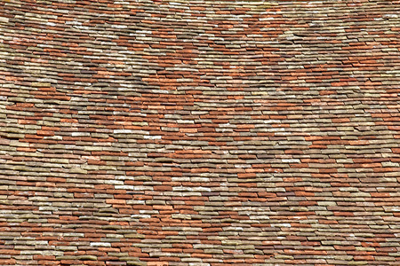 Wy dit joli village; France - may 24 2019 : old tiles on the roof of the tool museum in the pictureque village 에디토리얼