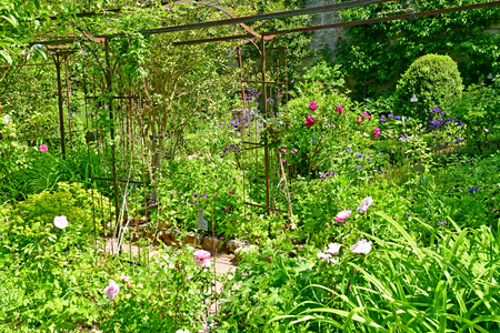 Wy dit joli village; France - may 24 2019 : the tool museum garden in the pictureque village 에디토리얼