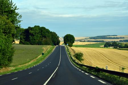 La Chapelle en Vexin, France - august 8 2019 : the D 6014 road between Magny en Vexin and Fleury sur Andelle