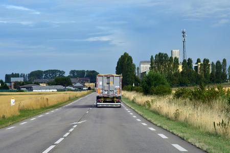 Grainville, France - august 8 2019 : the D 6014 road between Magny en Vexin and Fleury sur Andelle