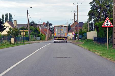 Boisemont, France - august 8 2019 : the D 6014 road between Magny en Vexin and Fleury sur Andelle