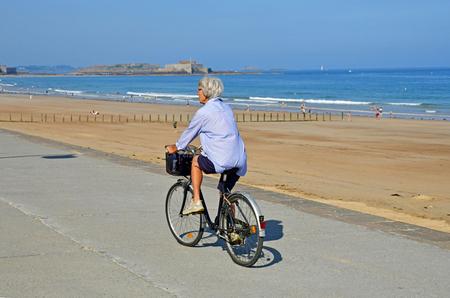 Saint Malo; France - july 28 2019 : cyclist near the Sillon beach Editorial