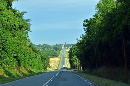 Les Thilliers en Vexin, France - august 8 2019 : the D 6014 road between Magny en Vexin and Fleury sur Andelle Sajtókép
