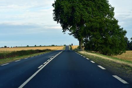 Magny en Vexin, France - august 8 2019 : the D 6014 road between Magny en Vexin and Fleury sur Andelle