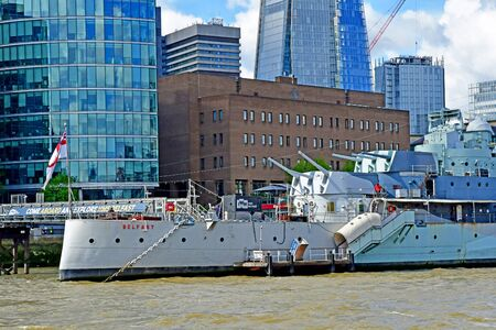London; England - may 5 2019 : Thames river cruise in the city centre, the HMS Belfast