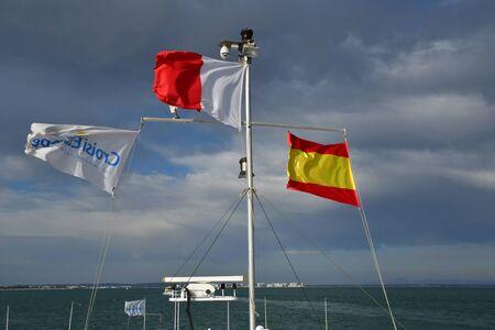 Cadiz; Spain - august 28 2019 : flags on a boat Stock Photo