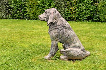 Mantes la Jolie, France - june 13 2018 : bronze dog statue 報道画像