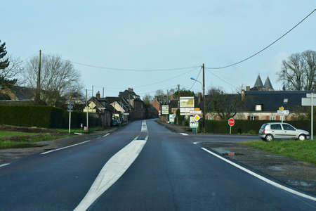 Ecouis, France - january 29 2020 : the D 6014 road between Magny en Vexin and Fleury sur Andelle