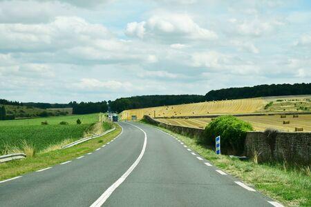 Les Thilliers en Vexin, France - august 8 2019 : the D 6014 road between Magny en Vexin and Fleury sur Andelle