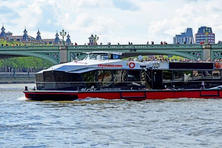 London; England - may 5 2019 : Thames river cruise in the city centre