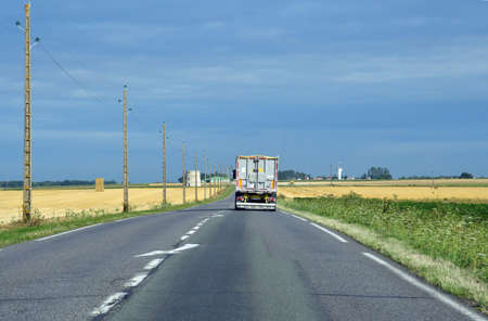 Suzay, France - august 8 2019 : the D 6014 road between Magny en Vexin and Fleury sur Andelle