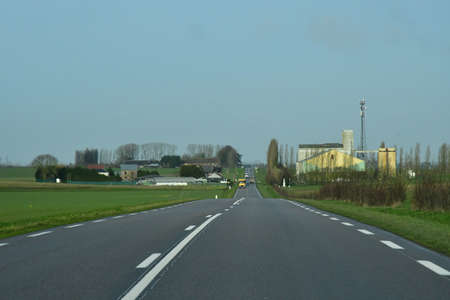 Ecouis, France - january 29 2020 : the D 6014 road between Magny en Vexin and Fleury sur Andelle Sajtókép