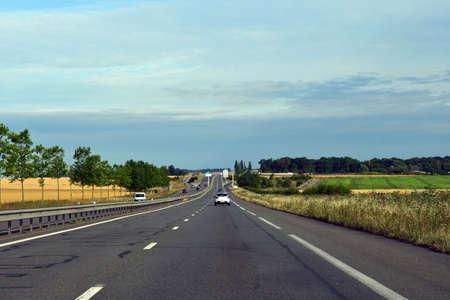 Magny en Vexin, France - august 8 2019 : the D 6014 road between Magny en Vexin and Fleury sur Andelle Sajtókép