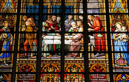 Belgium, the picturesque cathedral of Brussels stained glass window Editorial