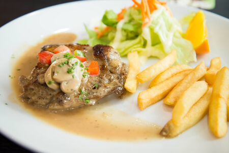 cuisine entertainment: Delicious nourishing steak with vegetables, French fries
