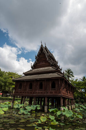 A wooden Pavilion in the country of Thailand photo