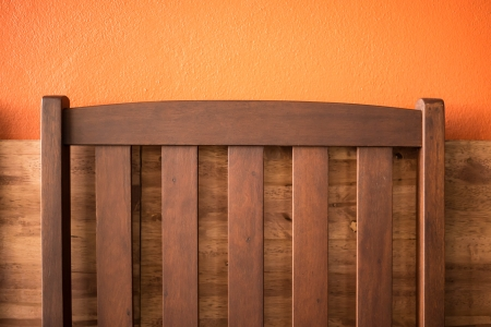 Backrest chair on the orange background in cafe. Stock Photo - 24429916