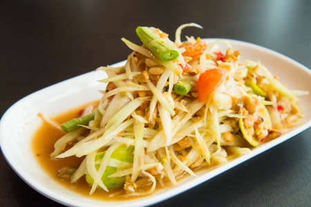 Green papaya salad on the table in the restaurant. Stock Photo - 24429928