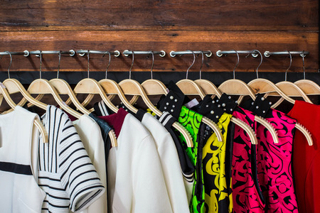 Many blouses on hangers in the dressing room Stock Photo - 25929087