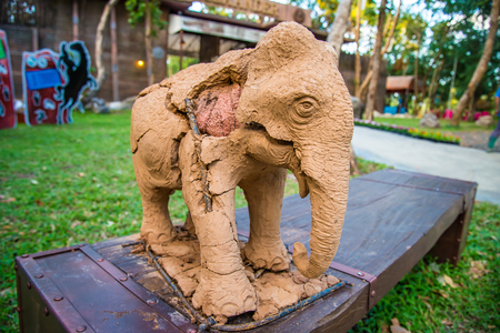 repaired: Elephant Statue the decay of repaired by potter. Stock Photo
