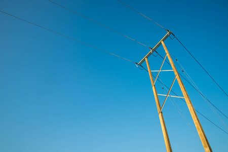 isolator insulator: Electricity post and a blue sky background.