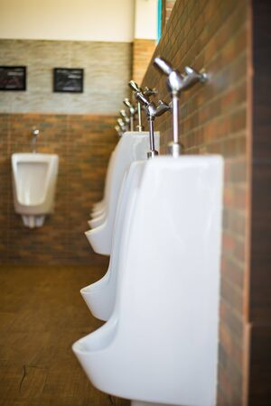 urinal: Urinal in the toilet of a restaurant. Stock Photo