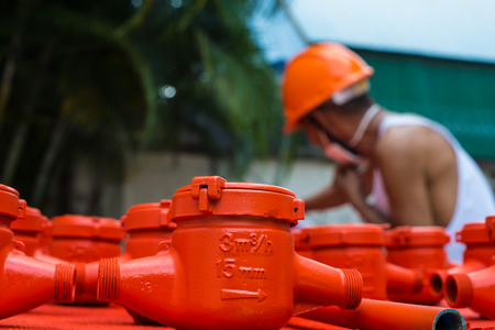Spraying color many water meter in the factory.