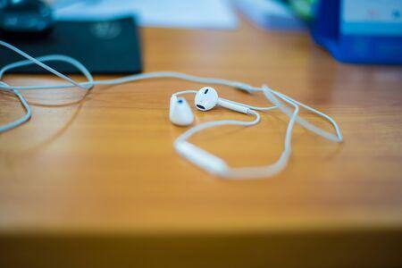 earphone: Earphone on a wooden table.Music,Listen
