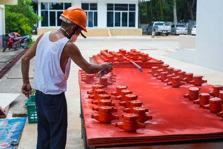 dispensing: Spraying color many water meter in the factory.
