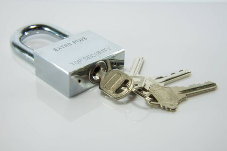 lock and key: Lock and key on white background.