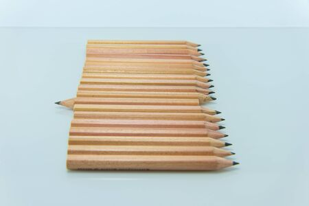 'odd one out': Short pencil on white background Stock Photo