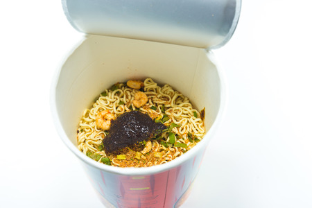 cooked instant noodle: cooked instant cup noodle with ingredient on white background