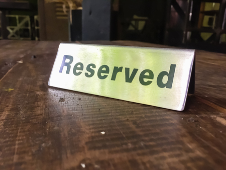 private party: Signs Reservation on the table in the restaurant. Stock Photo